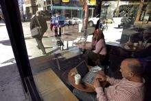 A man uses a wireless internet access at a Starbucks Coffee shop in San Francisco, California