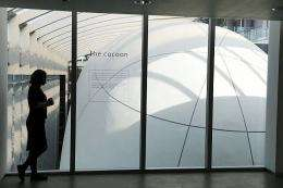 "A museum employee looks over the ""Cocoon"" at the Darwin Centre"