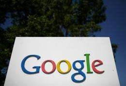 A sign is displayed outside of the Google headquarters in Mountain View, California