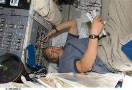 Astro_Mike: In space, everyone can hear you tweet (AP)