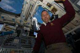 Astronaut's baby daughter born as he circles Earth (AP)