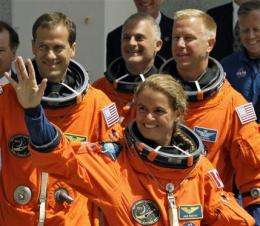 Astronauts board space shuttle for evening launch (AP)