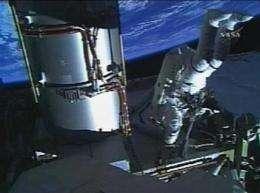 Astronauts successfully install solar wings (AP)