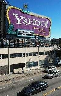 Cars drive by a Yahoo billboard