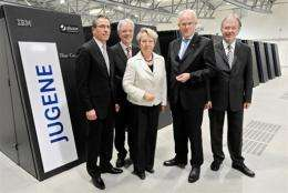 "Chairman of IBM Germany Martin Jetter (left) with other officials in front of the ""Jugene"" supercomputer"