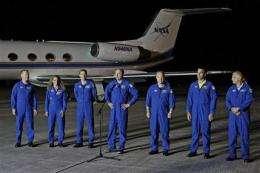Crew includes Twittering skipper, singer, ER doc (AP)