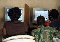 Customers browse the Internet in a cybercafe in Abidjan on August 11, 2009