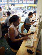 Customers surf the internet at a cyber cafe in London