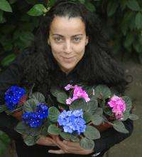 Dr. Nadia Kadi with African Violets