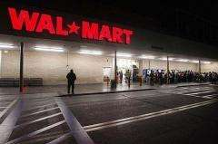 Early morning shoppers await the opening of a Wal-Mart store