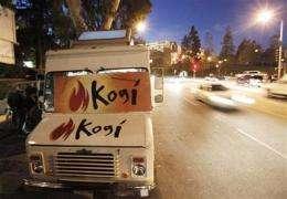 Foodies flock to Twitter-savvy food trucks (AP)