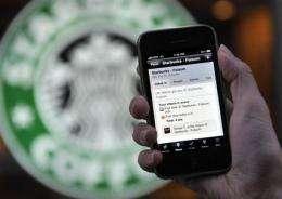Friends go online at Foursquare to meet offline (AP)