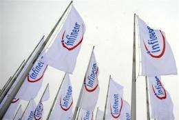 Infineon said it had managed to limit its quarterly loss but warned that full-year asset writedowns would be larger