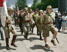 Japanese veterans in Imperial Army uniforms march in Tokyo
