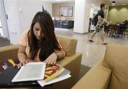 Kindle lightens textbook load, but flaws remain (AP)