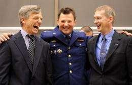 L-R: Astronauts Robert Thirsk, Roman Romanenko and Frank De Winne