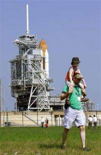 NASA gives unanimous 'go' for Saturday launch (AP)