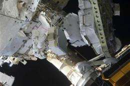 NASA patches air-purifying system on space station (AP)