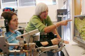 Physical therapists test mechanical arm to help patients recover from stroke, traumatic brain injury