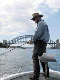 Retired surgeon David Hunt fishes on Sydney Harbour
