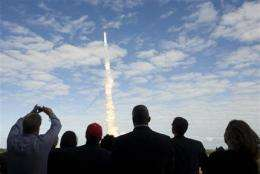 Shuttle nears space station, docking scheduled (AP)