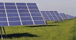 Solar collectors stand on a field near Straubing, southern Germany