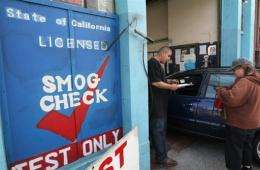 Station assistant helps a customer with an emissions test