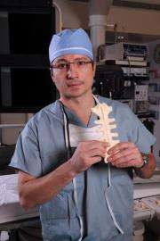 Surgeon 'gluing' the breastbone together after open-heart surgery