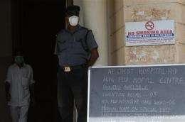 Swine flu closes more NYC schools, spreads in Asia (AP)