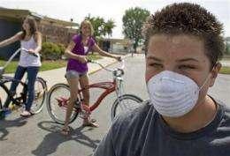 US no longer advising schools close for swine flu (AP)