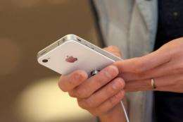 A customer looks at the white iPhone 4
