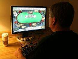 A man plays poker on his computer