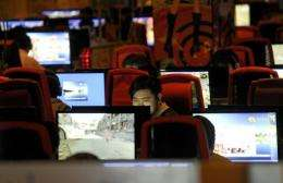A man surfs the Internet at a coffee shop in Beijing