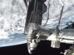 Astronauts get busy with space station stockpiling (AP)