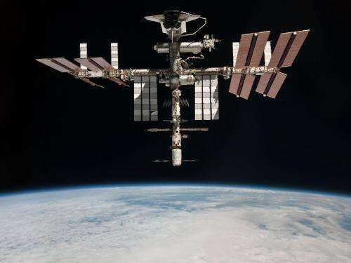 NASA releases first photo of shuttle docked in space