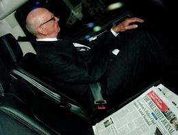 News Corporation Chief Rupert Murdoch is pictured with a copy of the Wall Street Journal newspaper