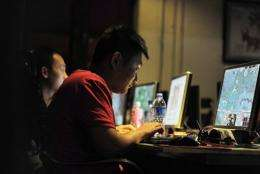 People at an internet cafe in Beijing in May