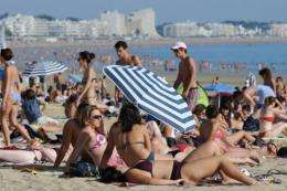 Sunbathers on the beach at La Baule, western France, during unusually warm weather in October