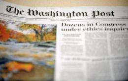 The Washington Post Co. said revenue was flat in its newspaper publishing division in the first quarter