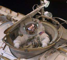 This NASA image shows astronaut Drew Feustel as reentering the space station after completing an 8-hour, 7-min spacewalk