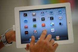 A man navigates through the iPad 2