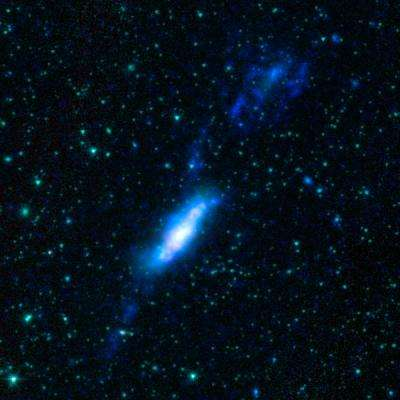 The Spitzer photo atlas of galactic 'train wrecks'