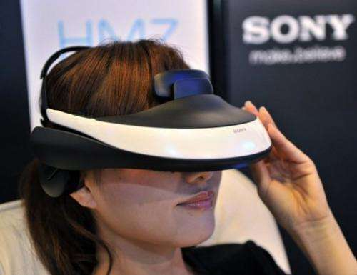 A model displays the new Sony 3D head mount display during an unveiling ceremony in Tokyo