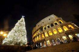 A picture from last week showing a Christmas tree in front of the ancient Colosseum in Rome
