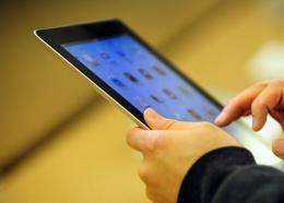 Customers try the Ipad 2 at the Apple store in New York