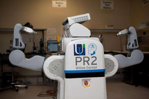University of Ulster celebrates acquisition of PR2 robot by having it solve Rubik's cube