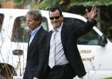 Actor Charlie Sheen (R) leaves court after attending a hearing at the Pitkin County Court house in Aspen, Colorado