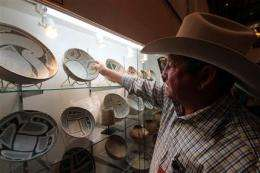 After raids, artifact dealers slowly regain trust (AP)