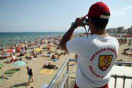 A life guard watches the beach at Canet-en-Roussillon, France, in August