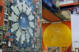 A life-sized photo of the Tevatron particle accelerator's detector hangs from a beam
